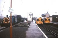 Station scene at Sandown, Isle of Wight, in February 1988. On the right are two of the local trains based on ex-London Transport tube stock, while on the left BR Class 03 0-6-0 DM no 03079 stands with permanent way vehicles. The locomotive, which also carried the numbers D2079 and 97805 during its lifetime, is now preserved on the Derwent Valley Light Railway.<br><br>[Ian Dinmore&nbsp;/02/1988]