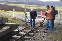 Permanent way maintenance taking place at the west end of the Leadhills station on 15 March 2012.<br><br>[Bill Roberton&nbsp;15/03/2012]