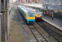 A Virgin Voyager waits at the east end of platform 3 at Chester station on 21 March 2012 as an Arriva Trains Wales Class 175 passes on the centre road to gain access to the west end of the platform. <br><br>[John McIntyre 21/03/2012]