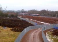 Work continues on the North Chord embankment at Nuneaton on 12 February 2012 as an up Pendolino storms past on the WCML in the background. [See image 36137]<br><br>[Ken Strachan&nbsp;12/02/2012]