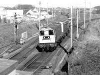 A southbound permanent way train runs through Carstairs on 17 April 1980 behind 20137+20124. The train is about to pass Strawfrank (now Carstairs South) Junction with the direct Edinburgh line branching off to the right.<br><br>[John Furnevel&nbsp;17/04/1980]
