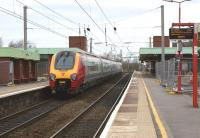 A Birmingham - Edinburgh Virgin Voyager calls at Wigan North Western on 21 March 2012. Like several other Virgin stations in the North-West, there are extensions to accommodate 11 car Pendolinos with extensive resurfacing work being carried out.<br><br>[John McIntyre&nbsp;21/03/2012]