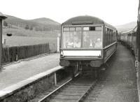 Trains on the Kyle line pass at Achanalt in July 1962 with the photographer getting a cheery wave from passengers in the observation car [see image 25980].<br><br>[R Sillitto/A Renfrew Collection (Courtesy Bruce McCartney)&nbsp;/07/1962]