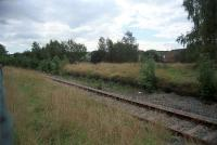 Looking south west across the remains of the platforms at Nelson and Llancaiach. Much of the route of the Taff Vale Extension in this area is now a cyclepath and I had a very pleasant cycle along the route that day in 2002.<br><br>[Ewan Crawford&nbsp;/09/2002]