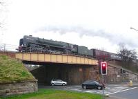 'The Auld Reekie' charter, hauled by Britannia Pacific no 70013 <I>Oliver Cromwell</I> westbound on the Edinburgh 'sub' on 24 March 2012 on its way back to Manchester Victoria. The train is seen here crossing Lady Road at Cameron Toll on Edinburgh's southside.<br><br>[Jim Peebles&nbsp;24/03/2012]
