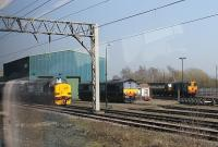 Direct Rail Services' Gresty Bridge Depot, as seen from a Shrewsbury to Crewe train on 24 March 2012. The picture shows newly painted EE Type 3 No. 37259, which had just been reinstated after a period in store, along with DRS Class 66 No. 66431, a <I>Northern Belle</I> liveried Class 47 and a Class 20. The train was held here at a signal for some time and the conductor announced that the delay was due to 'trains going in and out of Crewe station', which was probably all we passengers needed to know. <br><br>[Mark Bartlett&nbsp;24/03/2012]