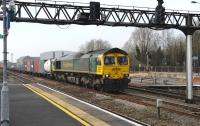 Freightliner 66594 with eastbound containers through Swindon station on 22 March 2012.<br><br>[Peter Todd&nbsp;22/03/2012]