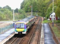 A southbound train leaves Dunkeld on an Inverness - Glasgow Queen Street service in May 2003 after a shower of rain.<br><br>[John Furnevel&nbsp;29/05/2003]