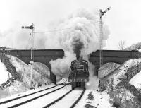 The Midland Compound No. 1000, double heading with Jubilee No. 5690 'Leander'  passing the overbridge immediately north of Kirkby Stephen station while working the southbound Cumbrian Mountain Pullman of 12th February 1983. The pair had worked north in atrocious conditions the previous Saturday. <br><br>[Bill Jamieson&nbsp;12/02/1983]