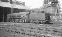 Rebuilt Merchant Navy Pacific no 35014 <I>Nederland Line</I> standing in the shed yard at Nine Elms in the 1960s. The locomotive was withdrawn in March 1967.<br><br>[K A Gray&nbsp;//]
