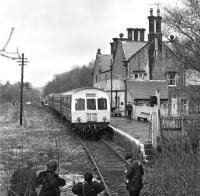Class 101 power car No. E51437 is the centre of attention for a small band of enthusiasts who have just travelled on the early afternoon service from Haltwhistle on 27th March 1976. <br><br>[Bill Jamieson&nbsp;27/03/1976]