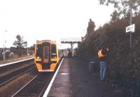 Hedge trimming in progress at Salhouse station, Norfolk, on a pleasant September afternoon in 1993 as a 158 pulls into the southbound platform with a Sheringham - Norwich service.<br><br>[Ian Dinmore&nbsp;/09/1993]