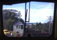 Lairg North box seen from the rear of a Type 2-hauled engineer's train on a fine Summers day in 1974. The photographer was en route from Inverness to Rogart to earn overtime on PW duties, joining a local gang clearing up the debris left by a freight train derailment.<br><br>[David Spaven&nbsp;//1974]