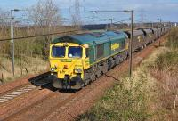Freightliner 66544 approaches the former Camps Junction with a Leith - Killoch loaded coal train on 31 March 2012. [See image 25874]<br><br>[Bill Roberton&nbsp;31/03/2012]