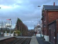 A 2004 view south over the level crossing at Nunthorpe showing the station building, signalbox, level crossing and the south end of the passing loop.<br><br>[Ewan Crawford&nbsp;20/03/2004]