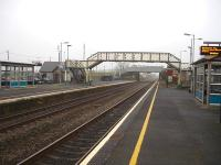 Pembrey & Burry Port station looking west. The brown wooden building beyond the footbridge is the local tourist information office and part time Arriva Trains Wales travel centre.  <br><br>[David Pesterfield&nbsp;15/03/2012]