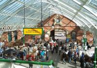 Weekend use of the considerable concourse space available under the recently refurbished glass roof at Tynemouth station on Saturday 31 March 2012. The view shows part of the popular Tynemouth weekend market in full swing.<br><br>[Colin Alexander&nbsp;31/03/2012]