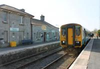 A Cardiff to Shrewsbury (Heart of Wales line) service pauses in the passing loop at Llandovery station while the driver exchanges single line tokens. ATW single unit 153367 stands opposite the refurbished station building, formally re-opened by the Prince of Wales in June 2011 after many years of disuse. The crew will continue to Llanwrtyd where they will swap trains with a Shrewsbury crew and return south.<br><br>[Mark Bartlett&nbsp;24/03/2012]