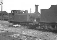 Class J88 0-6-0 no 68349 stands amongst the ashes at Eastfield shed in the late 1950s. The locomotive is recorded as being officially withdrawn from Grangemouth in November 1959.<br><br>[K A Gray&nbsp;//]
