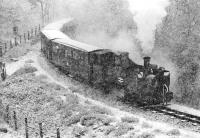 No. 9 <I>Prince of Wales</I>, on the 14.15 departure from Aberystwyth, having to cope with heavy snow as it struggles uphill about half a mile short of its destination at Devil's Bridge on 28 March 1975. The fireman can be dimly made out sanding from the front buffer beam in a scene more reminiscent of the Darjeeling Himalayan Railway.<br><br>[Bill Jamieson&nbsp;28/03/1975]