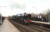Having handed over the 'Cumbrian Mountain Express' to 86259 at Farington Junction for the return to Euston, 70013 with support coach and WCRC 37676 head through Lostock Hall on 31 March 2012 on their way back to Carnforth.<br><br>[John McIntyre&nbsp;31/03/2012]