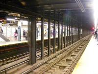 A rather quiet 42nd Street subway station on 26 February 2012. Signage for lines N R and Q can be seen to the left. In the distance a recently departed service enters the tunnel. <br><br>[Colin Harkins&nbsp;26/02/2012]