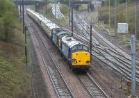Day 1 of the Pathfinder 'Easter Chieftan' railtour on 6 April 2012 was from Exeter to Dumbarton Central. Seven and a half hours into the journey sees the pair of DRS Class 37s  at Farington Curve Junction on the approach to Preston.<br><br>[John McIntyre&nbsp;06/04/2012]