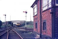 A Newquay - Par DMU approaching St Dennis Junction signal box in August 1987. View is north west from the Meledor Mill branch.<br><br>[Ian Dinmore&nbsp;/08/1987]