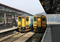 Twins at Swansea. Contrary to appearances these are two identical Sprinter <I>Bubble Cars</I>. However, 153320 on the left is seen from the original front end whereas 153303 on the right shows the converted former inner end from its days as part of a two car unit. The two units were waiting to form westbound trains.<br><br>[Mark Bartlett&nbsp;23/03/2012]