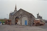 The former Fraserburgh locomotive shed in 1997. To the right was the station (now the B9033), goods yard (industrial estates and rough ground) and the harbour which is still in use. [See image 47834]<br><br>[Ewan Crawford&nbsp;03/02/1997]