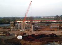 The setting sun lights up a down Pendolino on 2 March 2012 as it passes ongoing work on the accommodation bridge at Stoney Road that will form part of the Nuneaton North Chord.<br><br>[Ken Strachan&nbsp;02/03/2012]