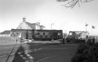 24129 crosses the A955 road at Dysart on 17 December 1975 with a brake van in tow. The train is heading back along the branch from Frances Colliery towards the exchange sidings and the main line. [See image 20372]<br><br>[Bill Roberton&nbsp;17/12/1975]