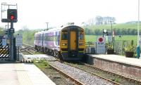 The 0941 Sheffield - Scarborough service arrives at Hunmanby over Bridlington Road level crossing on a bright and sunny 21 April 2009. A generally neat and tidy station, although a touch of weedkiller wouldn't go amiss.<br><br>[John Furnevel&nbsp;21/04/2009]