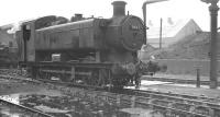 Hawksworth 0-6-0PT no 8467 stands in a wet Llanelli shed yard on 4 October 1961. The locomotive was withdrawn by BR the following February, while the shed itself, coded 87F, was officially closed in October 1965.<br><br>[K A Gray&nbsp;04/10/1961]