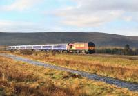 67016 with the Inverness portion of the Caledonian Sleeper north of Moy on the morning of 12 April. The Moy Burn runs past in the foreground.<br><br>[John Gray&nbsp;12/04/2012]