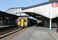The 0730hrs Saturday service from Pembroke Dock to Swansea, formed by ATW Sprinter 150281, calls at Llanelli. Much of this station's old infrastructure survives including the large awnings and footbridge seen here. <br><br>[Mark Bartlett&nbsp;24/03/2012]