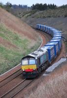 DRS 66430 coasts downhill to the south of Gleneagles on 12 April with the 4D47 Inverness - Mossend intermodal, composed entirely of Tesco containers.<br>  <br> <br>  <br><br>[Bill Roberton&nbsp;12/04/2012]