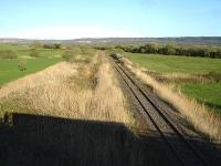 Looking west from the A484 Kidwelly bypass along the Gwendraeth Valley line before it disappears beneath undergrowth in the far distance. [See image 38432]<br><br>[David Pesterfield&nbsp;12/04/2012]