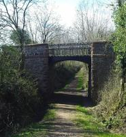 Cast-iron overbridge at Lodge of Kelton in April 2012 looking towards Kirkcudbright - now bypassed by a loop in the road over the infilled cutting. <br><br>[Colin Miller&nbsp;01/04/2012]