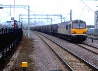 I have a soft spot for 92's. At the very least, they make a change from the ubiquitous 66's. 92030 <I>'Ashford'</I> is seen here passing through Rugby at about 7am on 9 March heading south with a mixed consist of tanks and flat wagons.<br><br>[Ken Strachan&nbsp;09/03/2012]