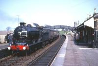 Platform scene at Anstruther in the early 1960s with Class J37 0-6-0 no 64602 at the head of a railtour from Dundee. Anstruther station closed to passenger traffic in September 1965.<br><br>[Robin Barbour Collection (Courtesy Bruce McCartney)&nbsp;//]