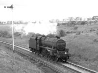 On Glasgow Fair Saturday 1966 Black 5 no 45018 shuffles south, light engine, at Craigenhill Summit heading home to 12A Carlisle Kingmoor. <br><br>[Colin Miller&nbsp;/07/1966]