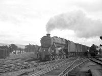 <I>'Not today thanks...'</I> seems to be the message from the driver of Black 5 no 45124 in July 1962 as he takes an express freight past a waiting banking locomotive at Beattock South and continues the journey north unabated.<br><br>[R Sillitto/A Renfrew Collection (Courtesy Bruce McCartney)&nbsp;/07/1962]