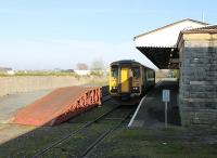ATW single unit 153320 waits at the Pembroke Dock branch terminus prior to returning to Carmarthen and Swansea, as seen from the buffer stops. Can anyone advise what sort of traffic the ramp on the disused platform line was used for?<br><br>[Mark Bartlett&nbsp;23/03/2012]