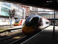 A recently introduced eleven coach Pendolino (390156) waits at Birmingham New Street with the 11.49 service to Wolverhampton on 17 April 2012. Across at platform 2 a sister set prepares to depart with a service for Euston.<br><br>[David Pesterfield&nbsp;17/04/2012]