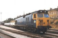 Class 50 no 50009 <I>'Conqueror'</I> stands at Laira in 1979 with a train of clayhoods.<br><br>[Ian Dinmore&nbsp;//1979]