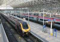 Platform 7 at Manchester Piccadilly sees Cross Country Voyager 221117 awaiting departure for Bristol Temple Meads. In Platform 5 a Pendolino is on a Euston service, which these days run at 20 minute intervals from here. <br><br>[Mark Bartlett&nbsp;23/03/2012]