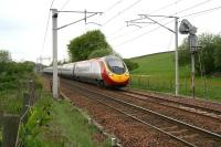 The 1150 Glasgow Central - London Euston Virgin Pendolino service at speed about to pass the site of the former Cleghorn station on 15 May 2008.<br><br>[John Furnevel&nbsp;15/05/2008]
