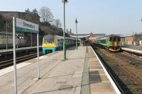 The striking London Midland livery of a 153/170 combination in Shrewsbury's bay platform contrasts with the Arriva Trains Wales blue of 175103. The LM units had arrived from Birmingham via Telford on 24 April and behind them was the 153 that had worked in from Swansea via the Central Wales line.  <br><br>[Mark Bartlett&nbsp;24/03/2012]