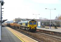A Westbury - Mount Sorrel ballast train heads east through Swindon on 22 March behind Freightliner 66602.<br><br>[Peter Todd&nbsp;22/03/2012]